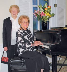 Emily Remington, seated, founder and guiding light of the Remington Concert Series, enjoys a musical moment with her friend, Annabelle Jenkins. Both are residents at Franke at Seaside.